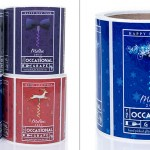 Rolls of custom wine labels with holiday label designs for Christmas and New Years.