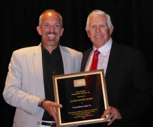 President Joel Carmany accepts Consolidated Label's award